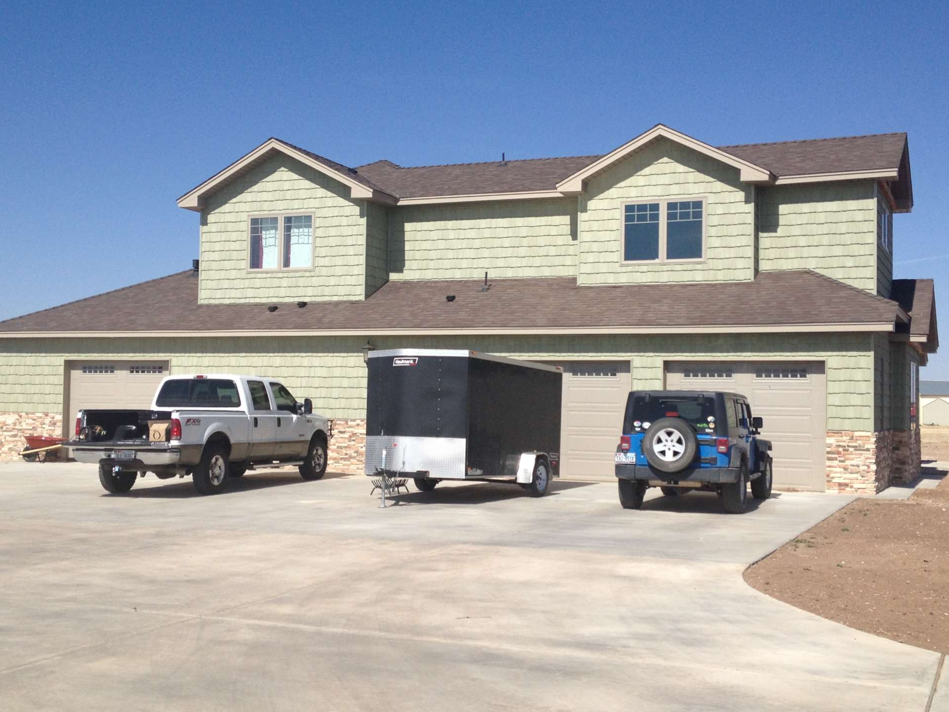 Back of custom home with 4 car garage