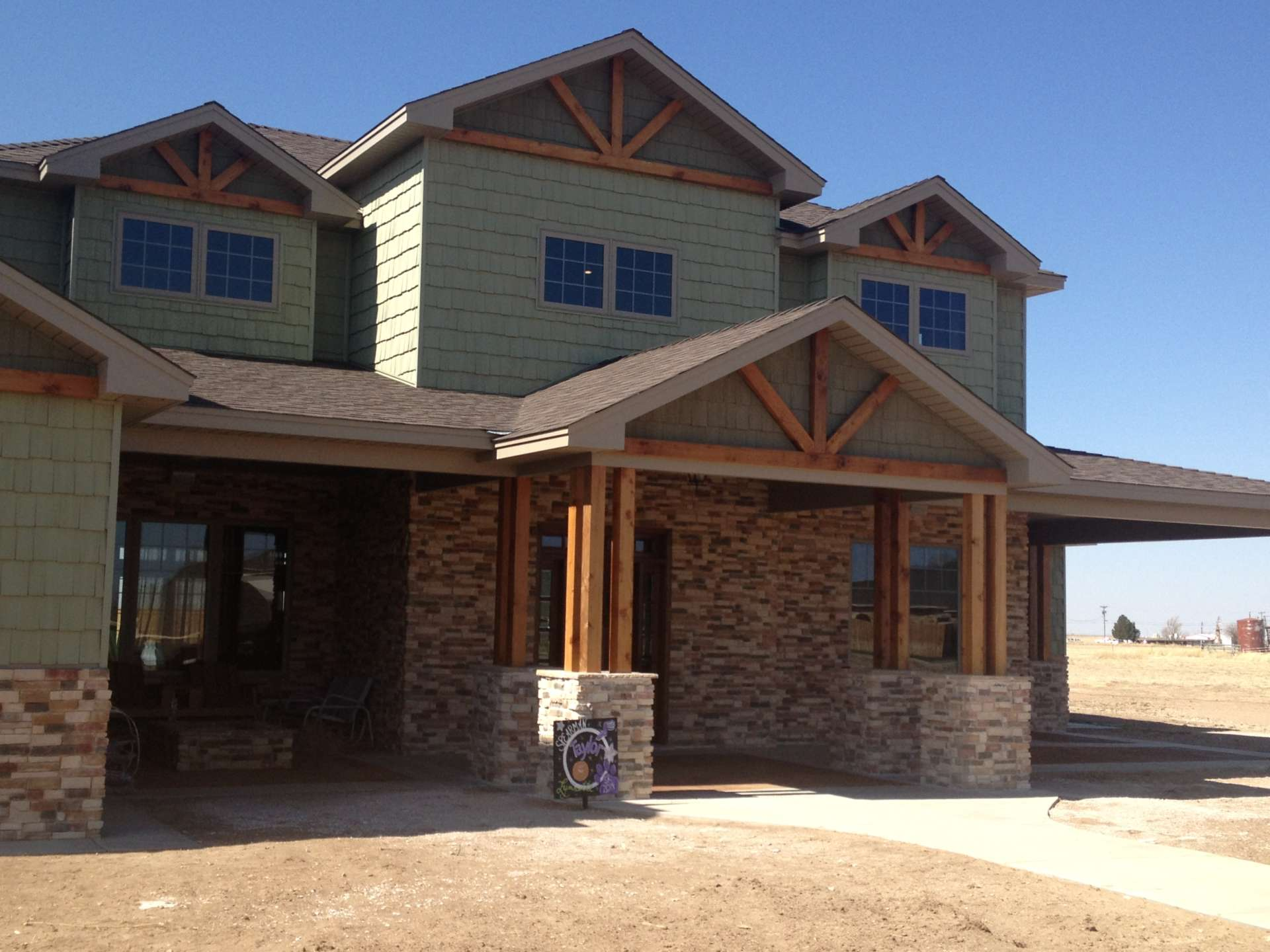 New cole stanley home with rustic porch in amarillo texas