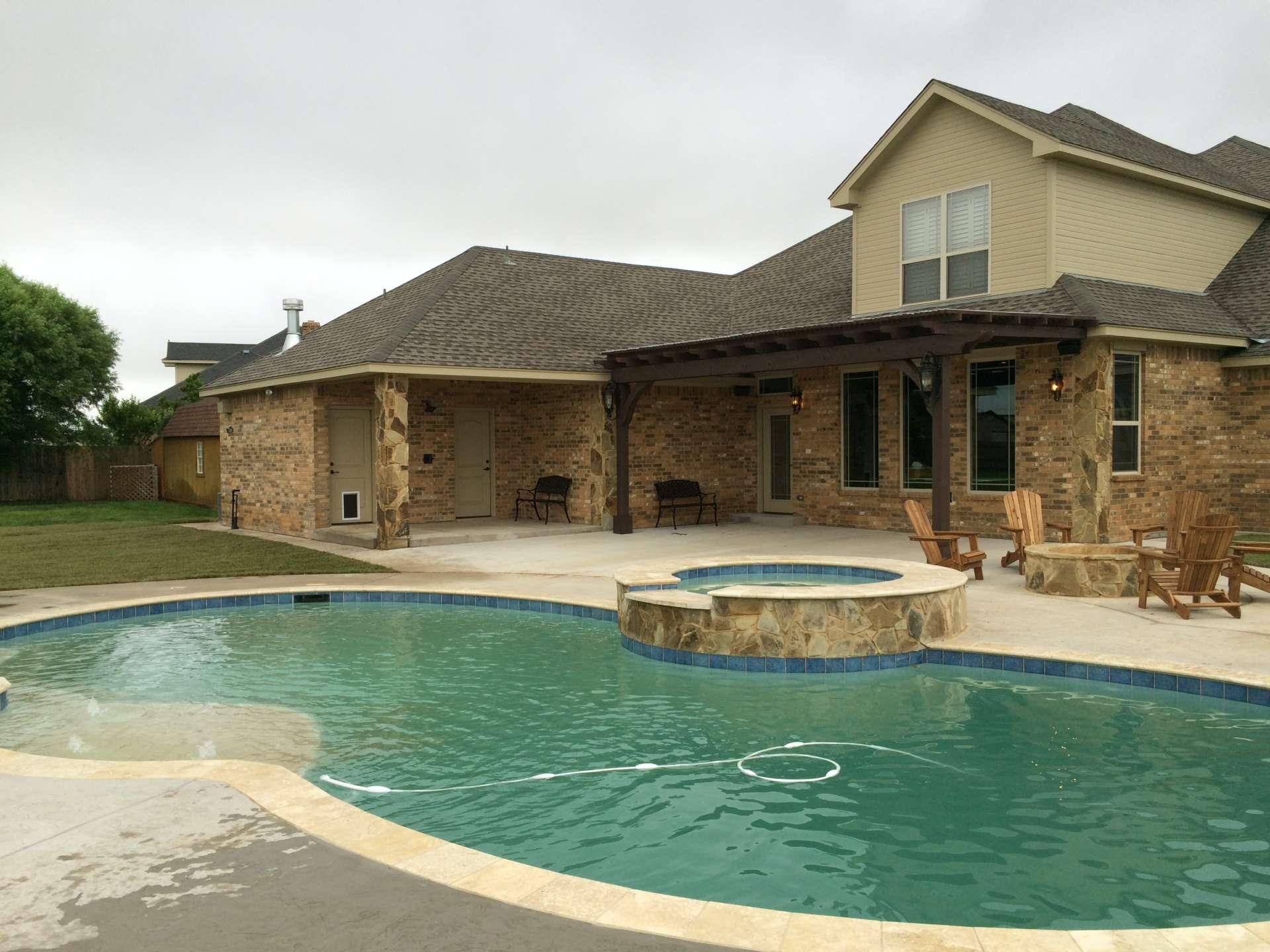 Custom patio, pool and hot tub
